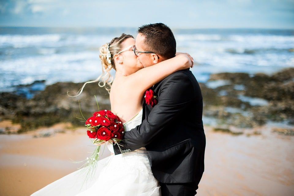 Couple kissing each other on their wedding day